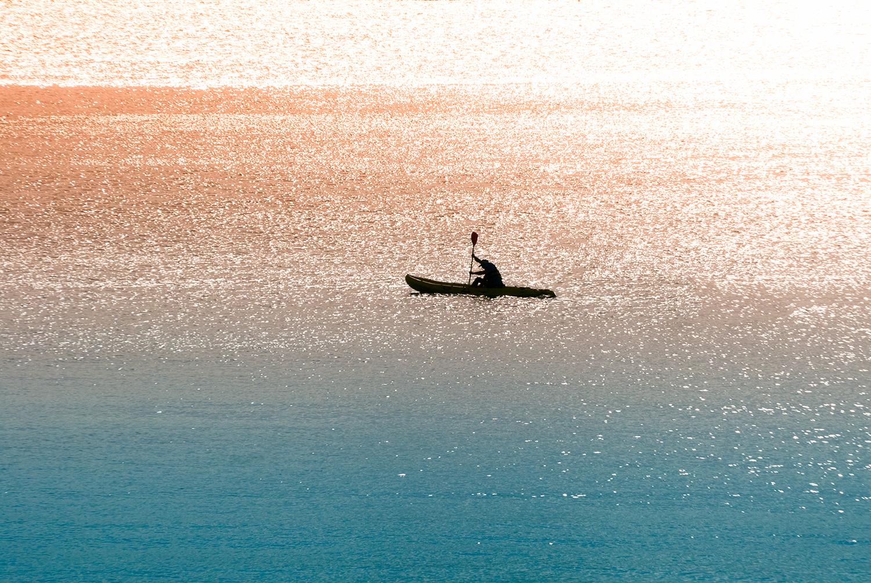 Sea canoeist at dawn example image 1