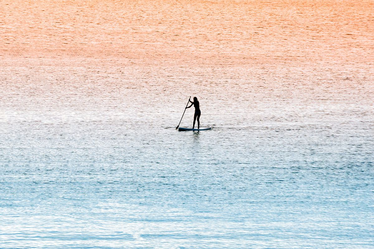 Standup paddle surfer girl example image
