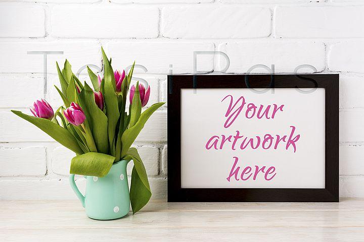 Black brown  landscape frame mockup with magenta tulips in mint green pitcher
