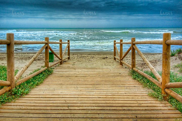 Wooden Promenade On The Beach