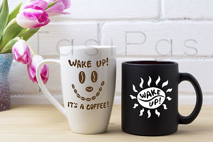 Black coffee cup and white cappuccino mug mockup with magenta tulip