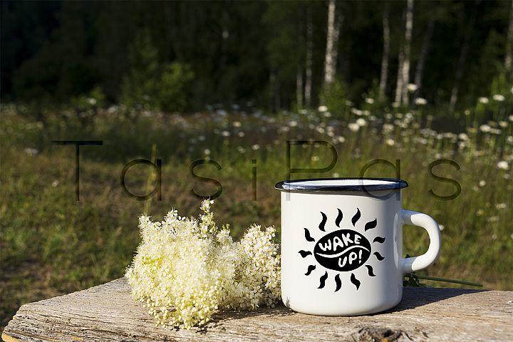 White campfire enamel mug mockup with white flowers