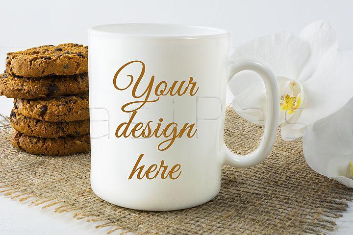 Coffee mug mockup with cookies