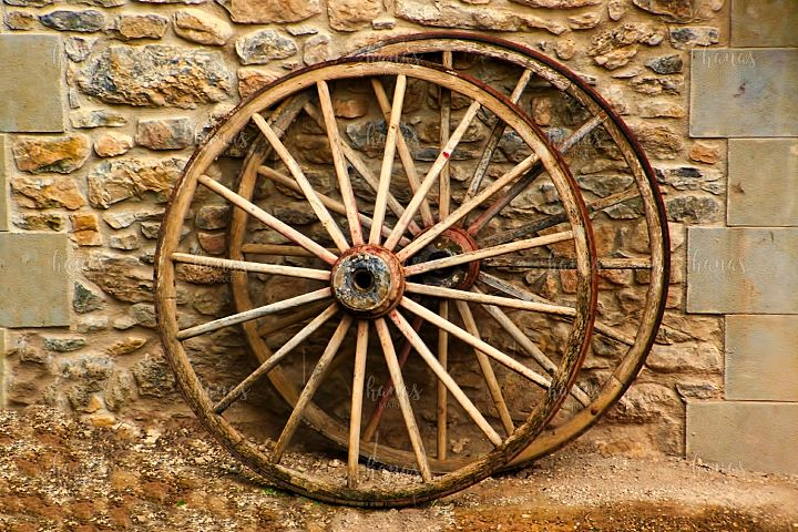 Two Carriage Wheels On The Wall