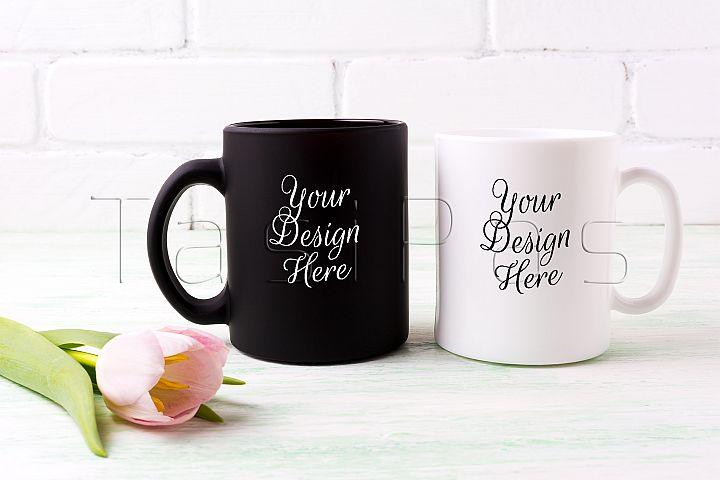 White and black mug mockup with  pink tulip.