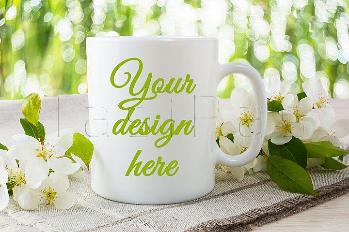 Mug mockup with apple blossom.