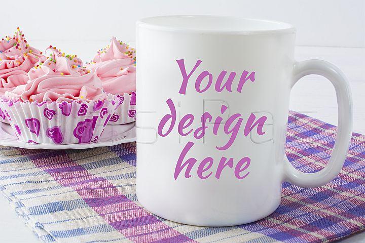 Coffee mug mockup with checkered napkin