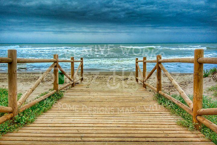 Wooden Promenade On The Beach