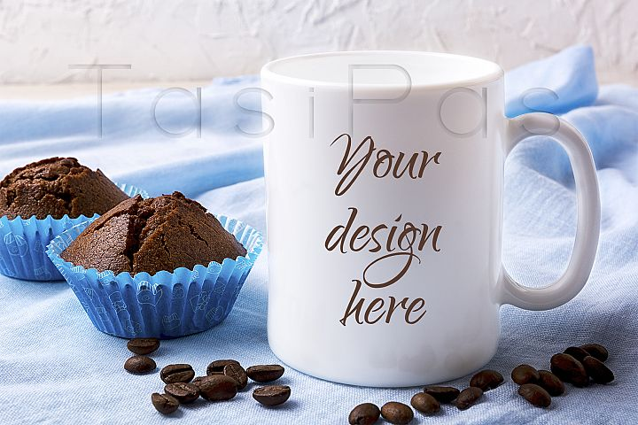 White mug mockup with coffee beans and two chocolate muffins