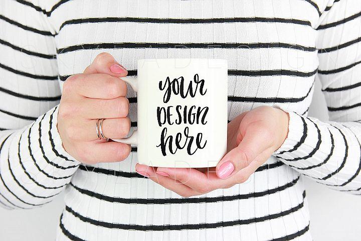 Woman holding white coffee mug mockup image