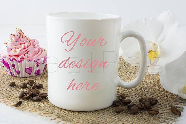 Coffee mug mockup with muffin